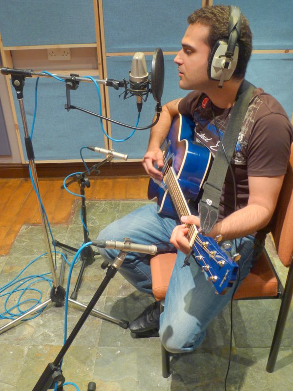 A singer songwriter mic'ed up and ready to record.